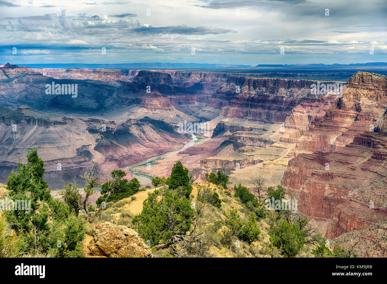 Grand Canyon National Park Arizona landscape view with the Colorado River in the distance. Layered bands of red Stock Photo