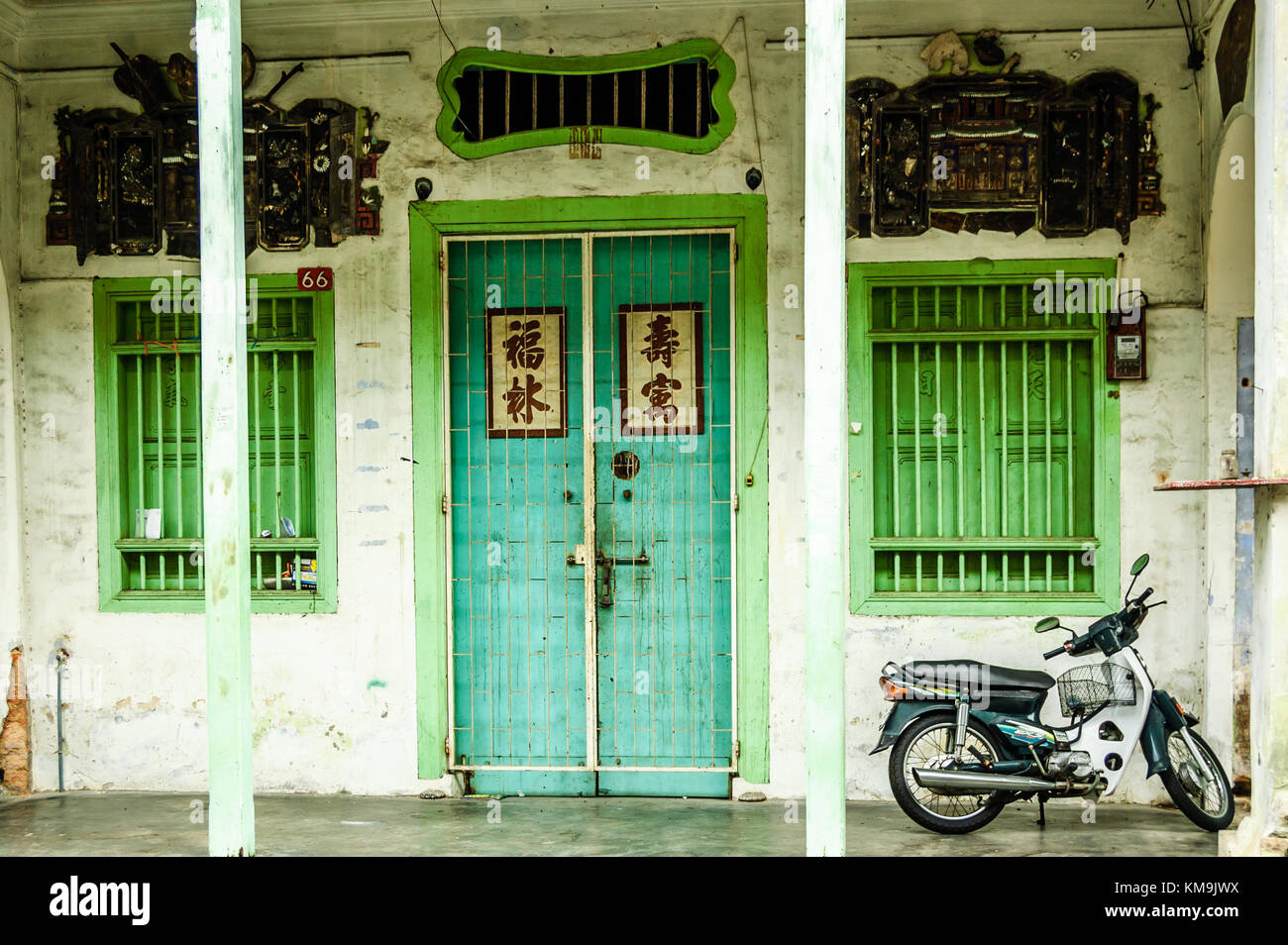 Penang, Malaysia - September 4, 2013: Old painted Chinese shophouse facade in historical George Town - Stock Image