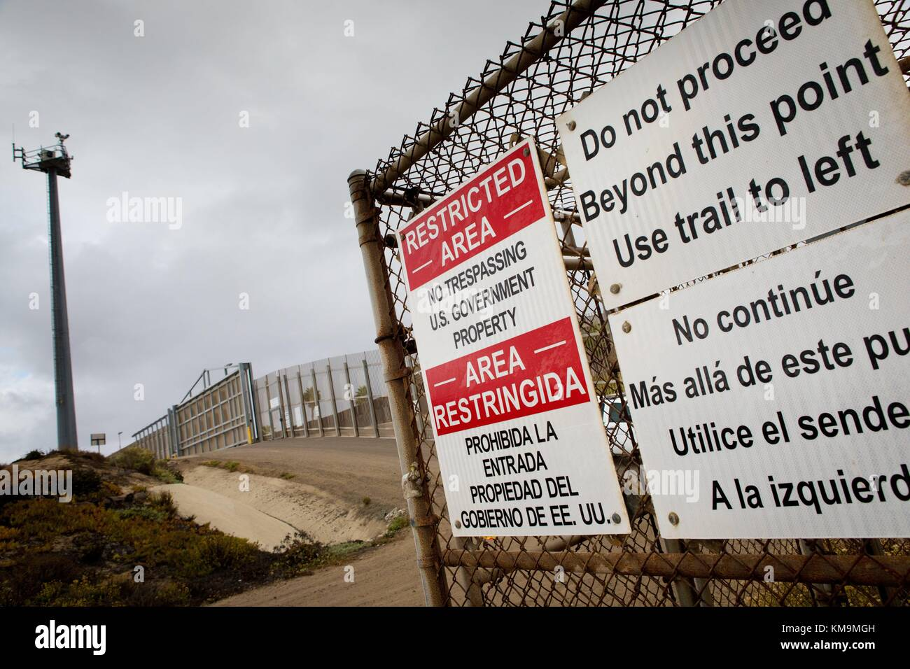Fence at the Mexico–United States border with 'No