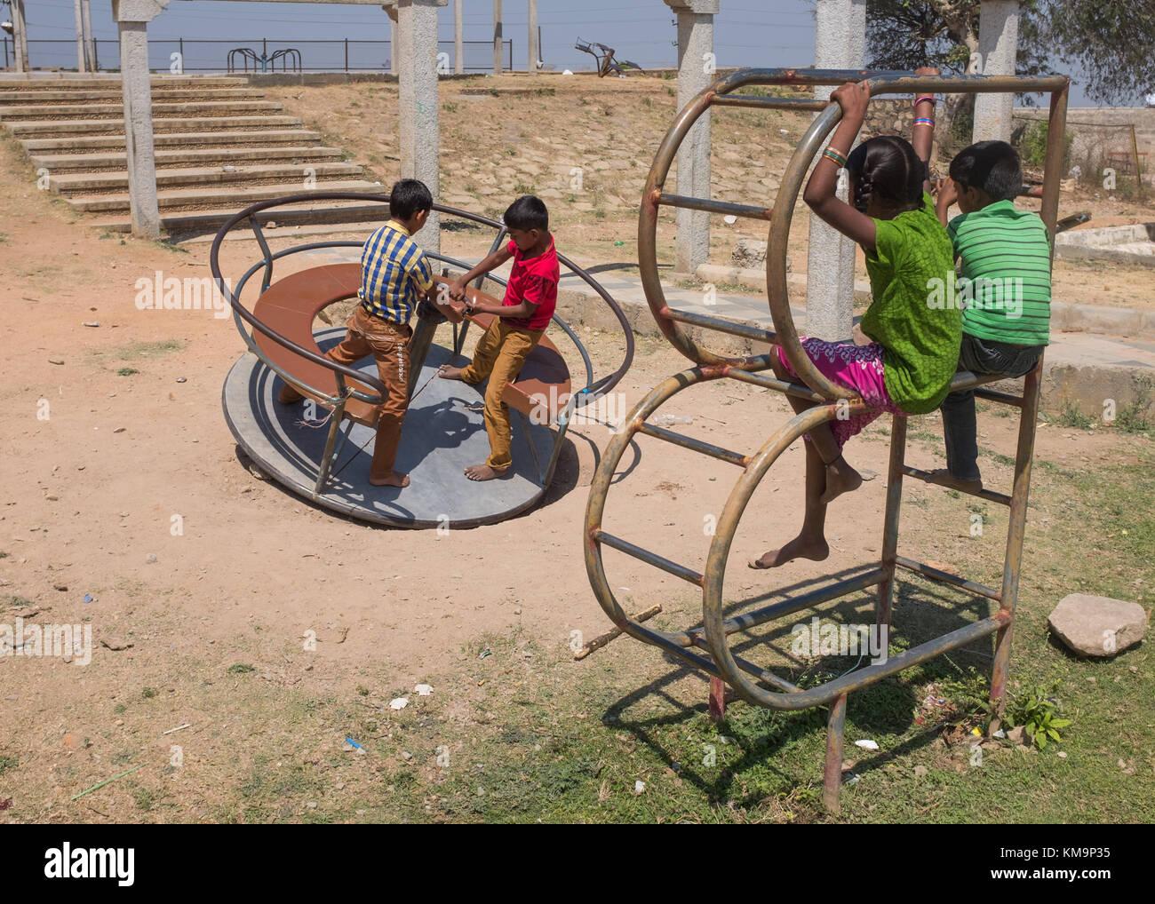 Children in playground, Mysore, Karnataka, India. - Stock Image