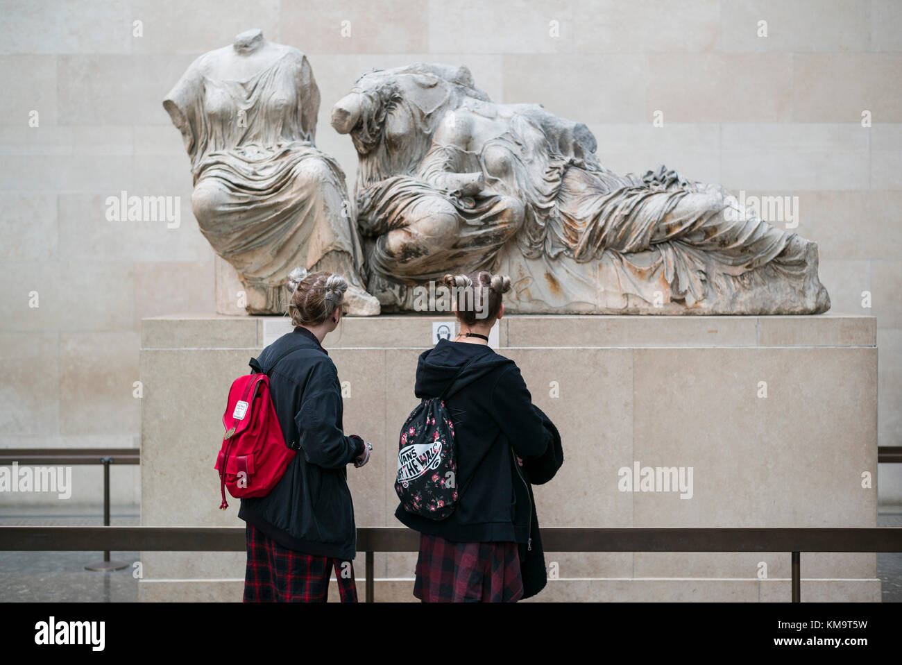 London. England. Visitors to the British Museum looking at the ancient Parthenon sculptures aka Elgin Marbles. Stock Photo