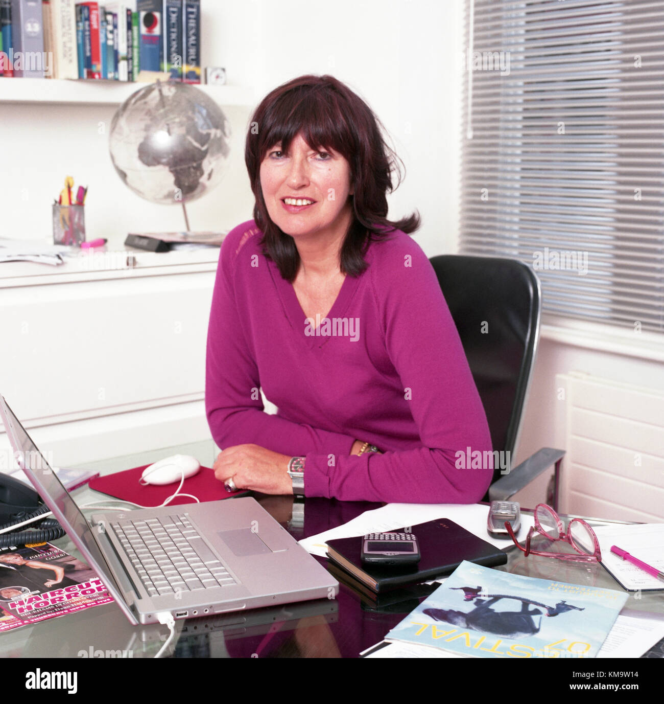 Janet Street-Porter, English media personality, journalist and broadcaster at the office for the deadline TV series, - Stock Image
