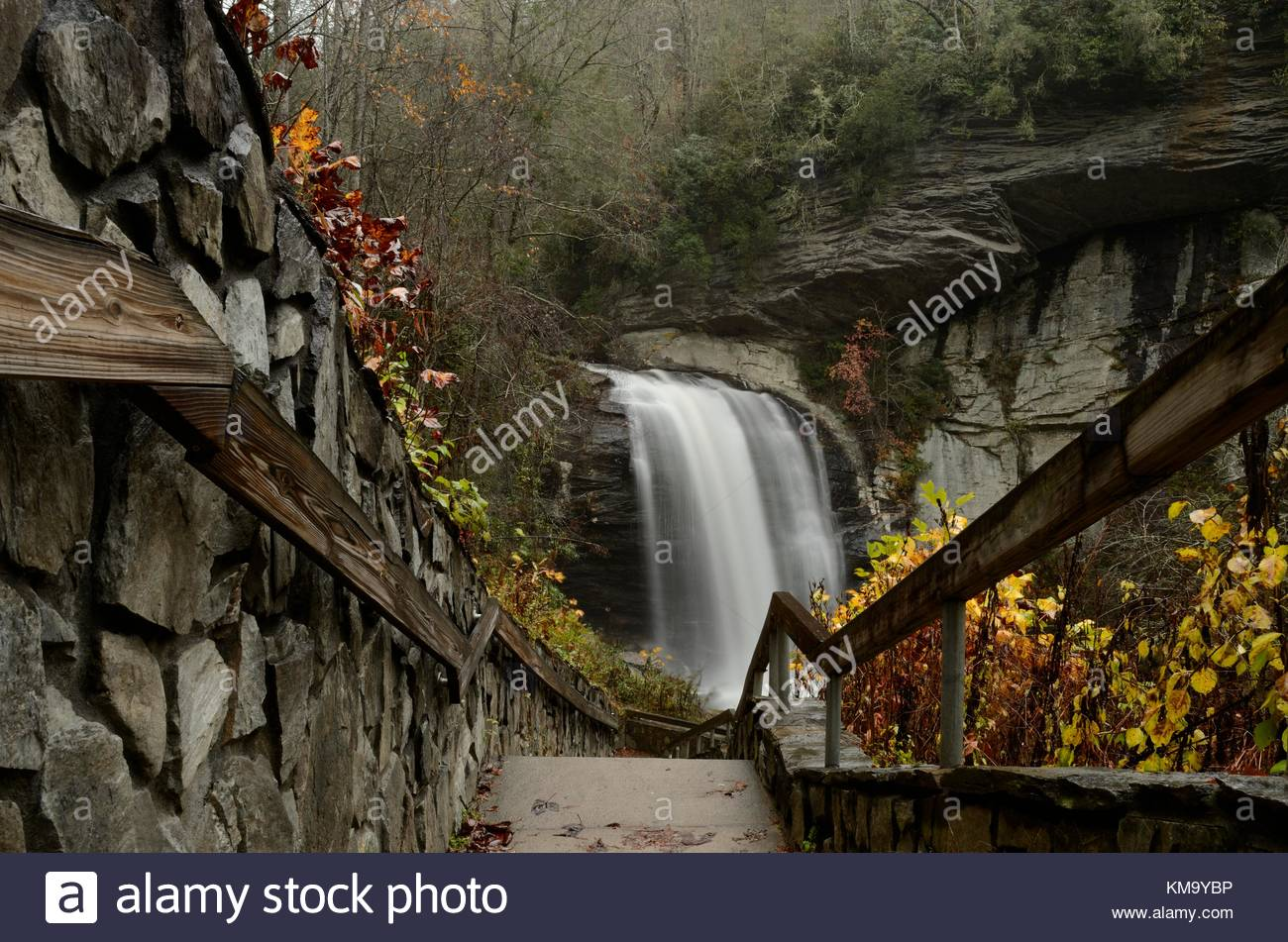 Wet pathway to Looking Glass Falls in North Carolina - North Carolina Waterfall west of Asheville and south of the - Stock Image