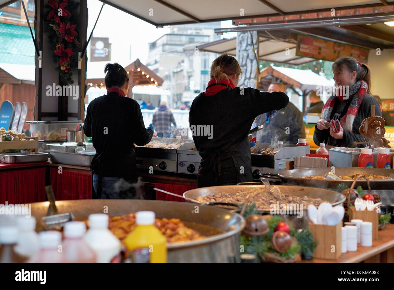 Nottingham Christmas market  2017 food being served on a food stall - Stock Image