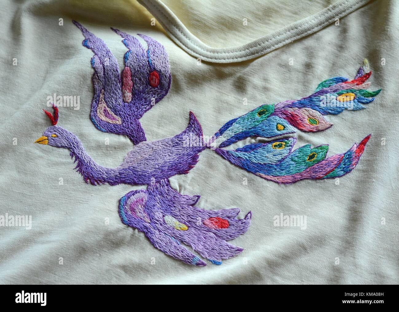 Hand embroidered firebird Stock Photo