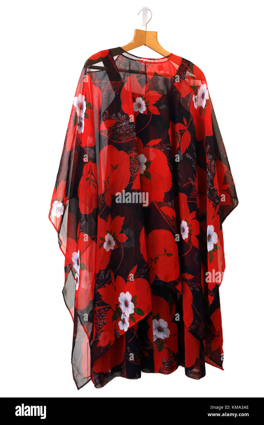 Sheer Chiffon Poncho with Red Flowers over Matching Evening Dress - Stock Image