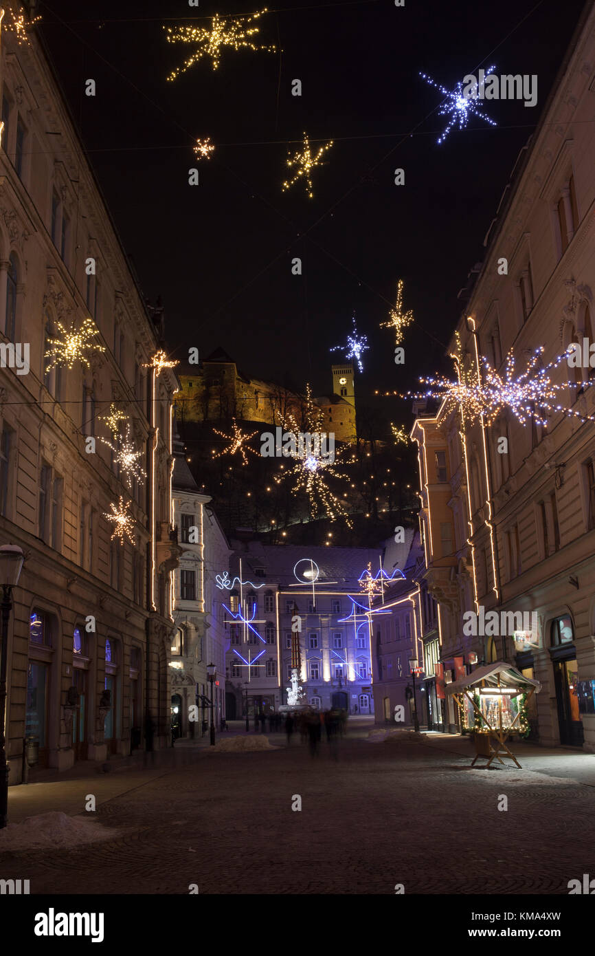 Ljubljana city center, historical core, triple bridge, castle, Presener square, church, with colorful lights decoration,during - Stock Image