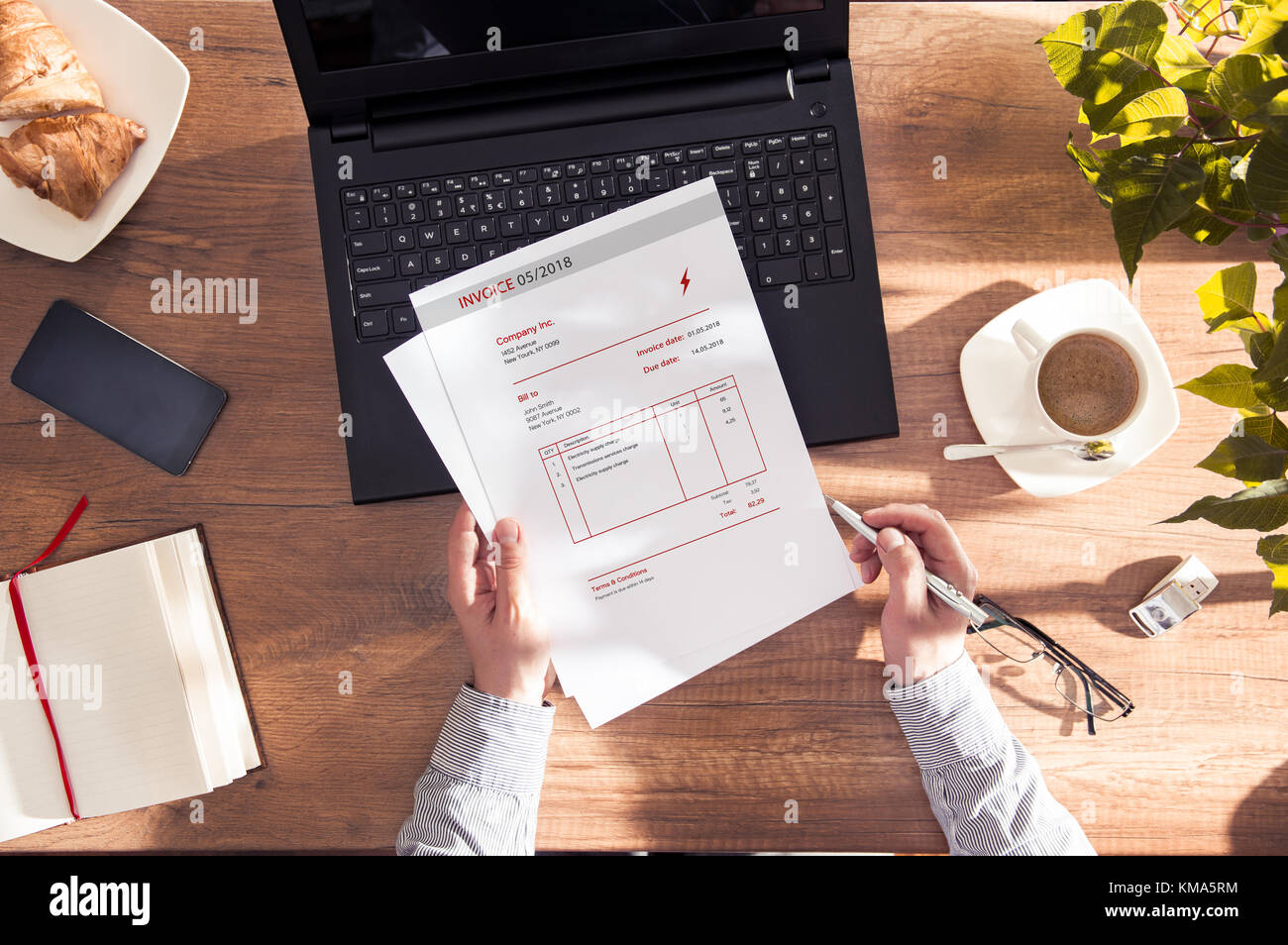 Man reads an invoice for electric power. Document made in graphic program Stock Photo