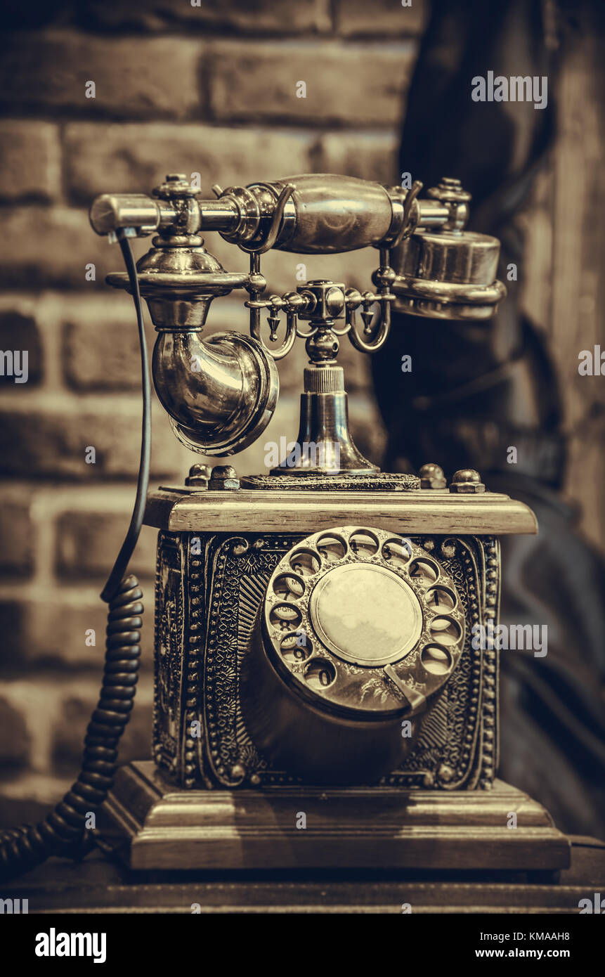 Brass antique vintage analog telephone, concept backgrounds object retro. - Stock Image