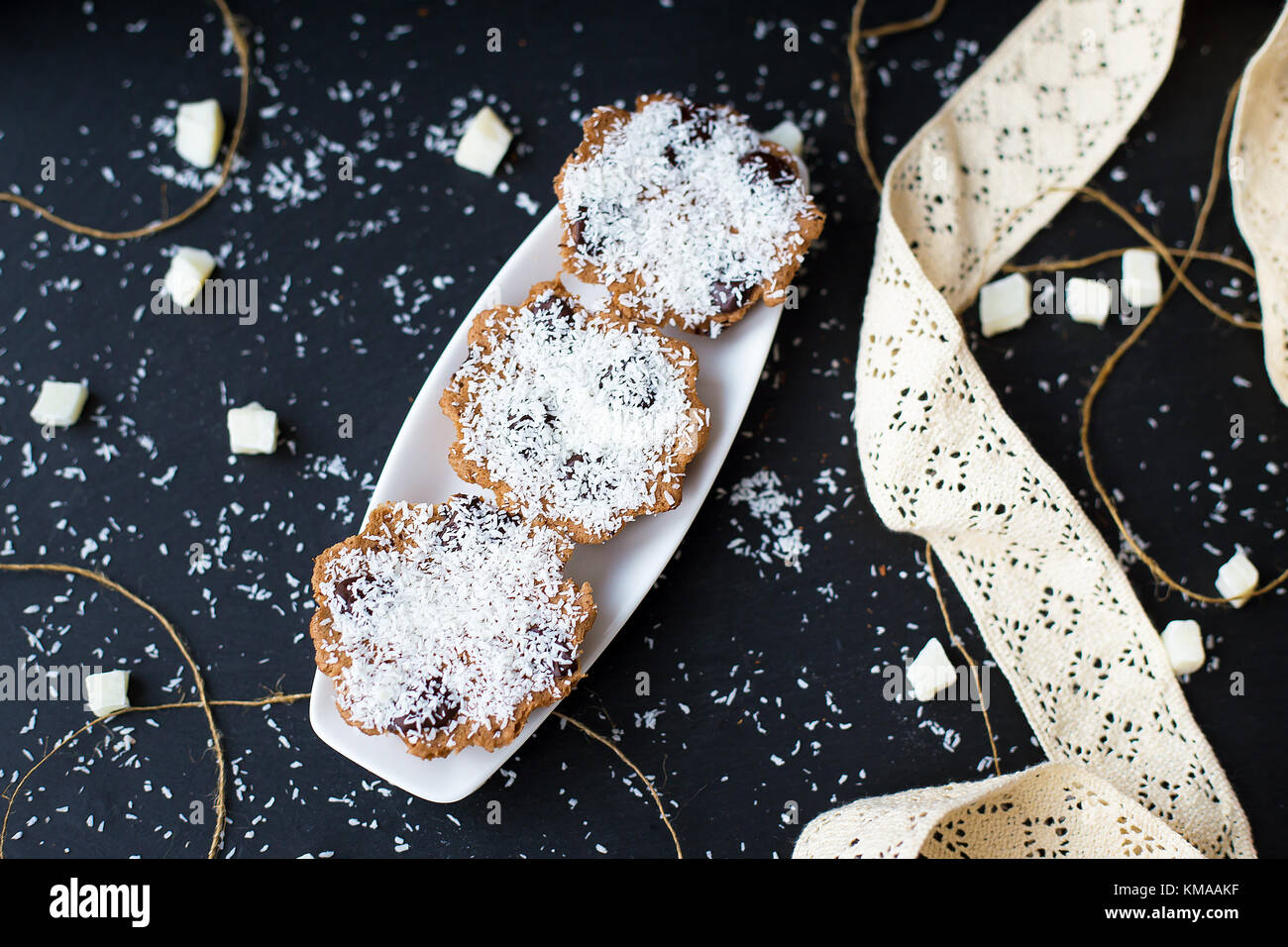 coconut muffins on a black background - Stock Image