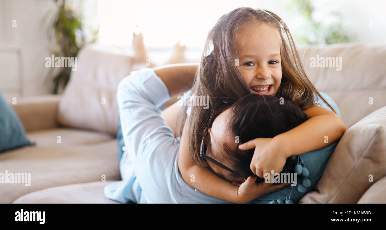 Portrait of father and daughter playing at home - Stock Image
