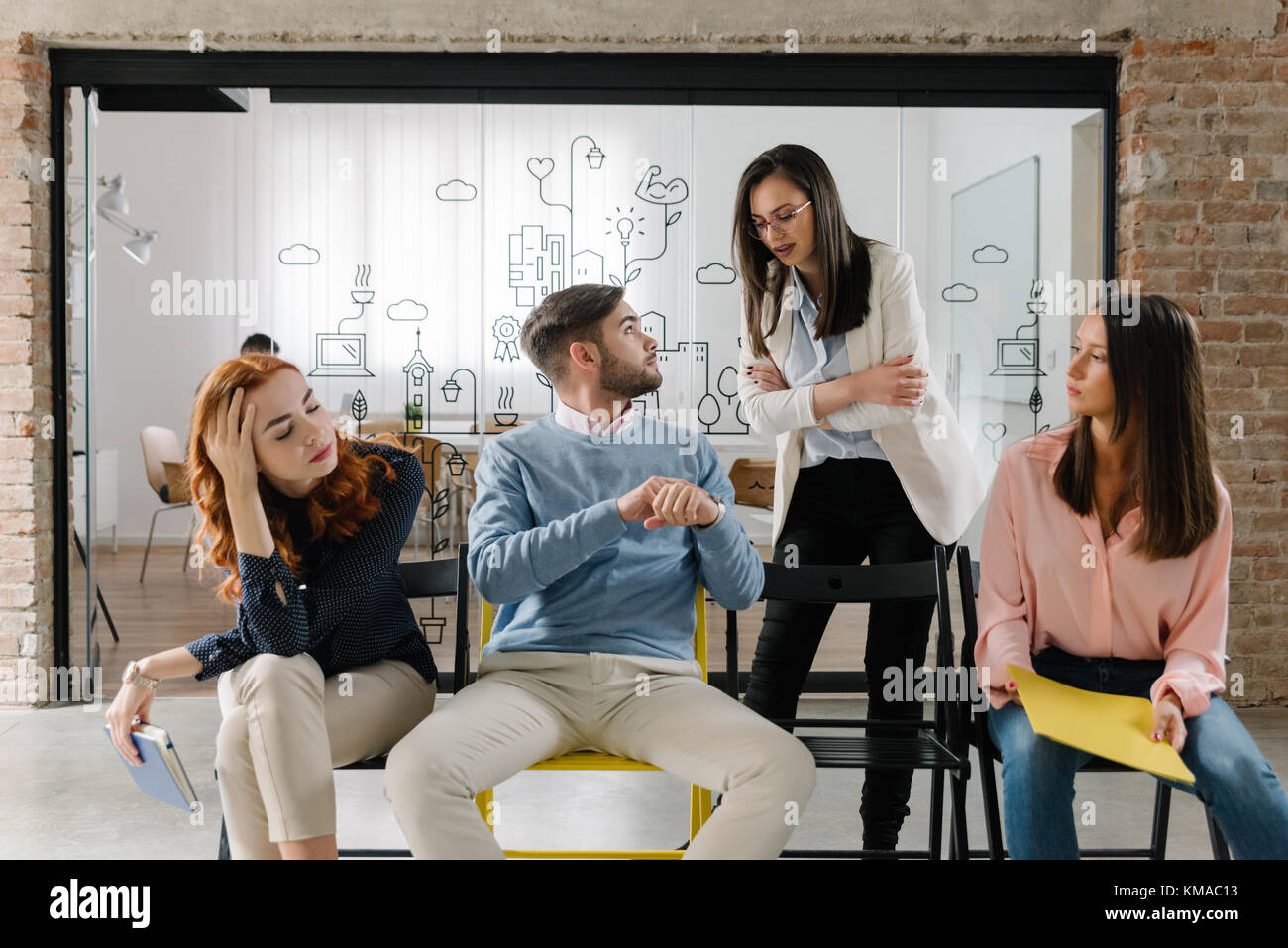 Small talk in the waiting room before a job interview - Stock Image