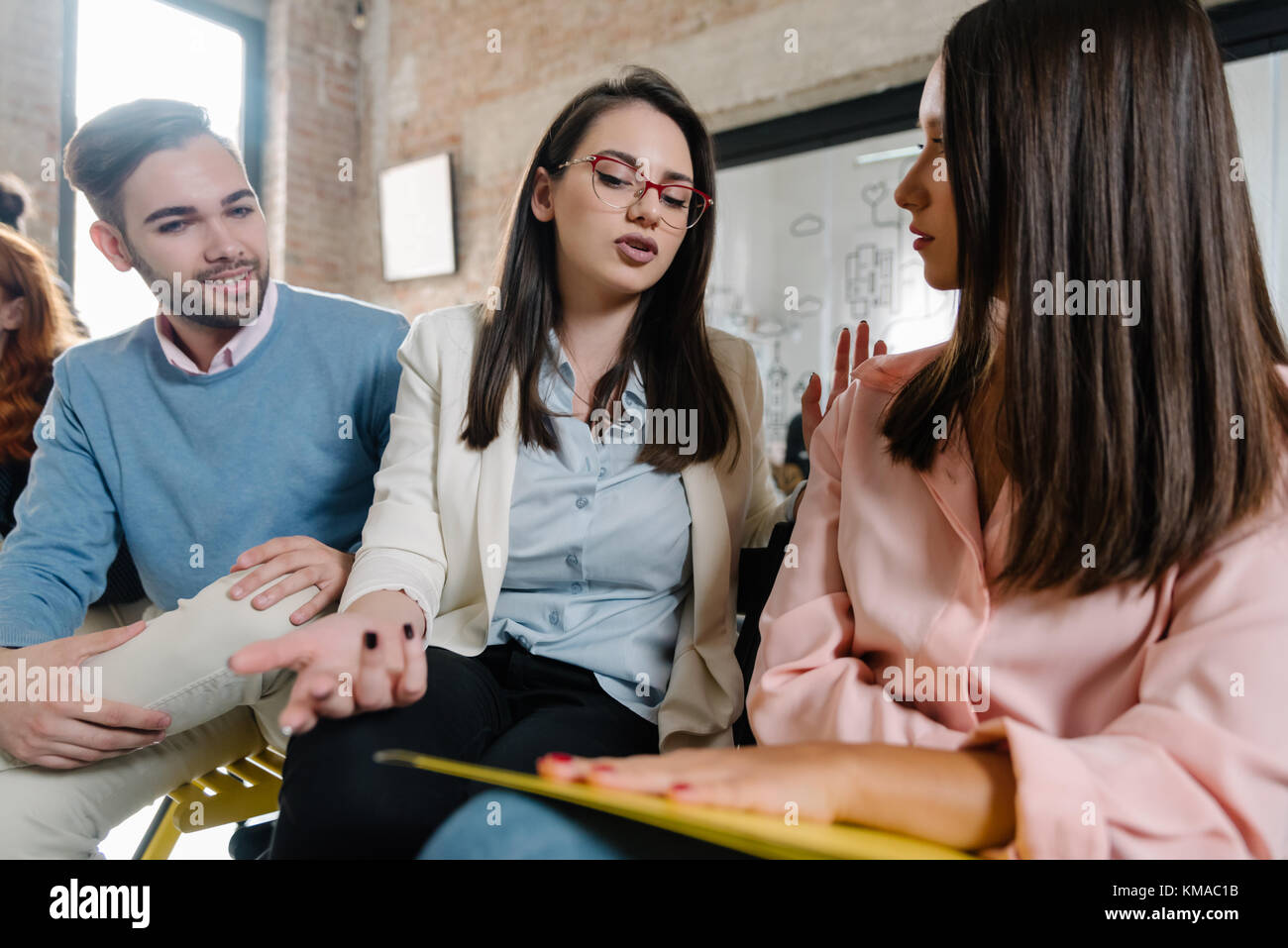 Job candidates talking before their interview Stock Photo
