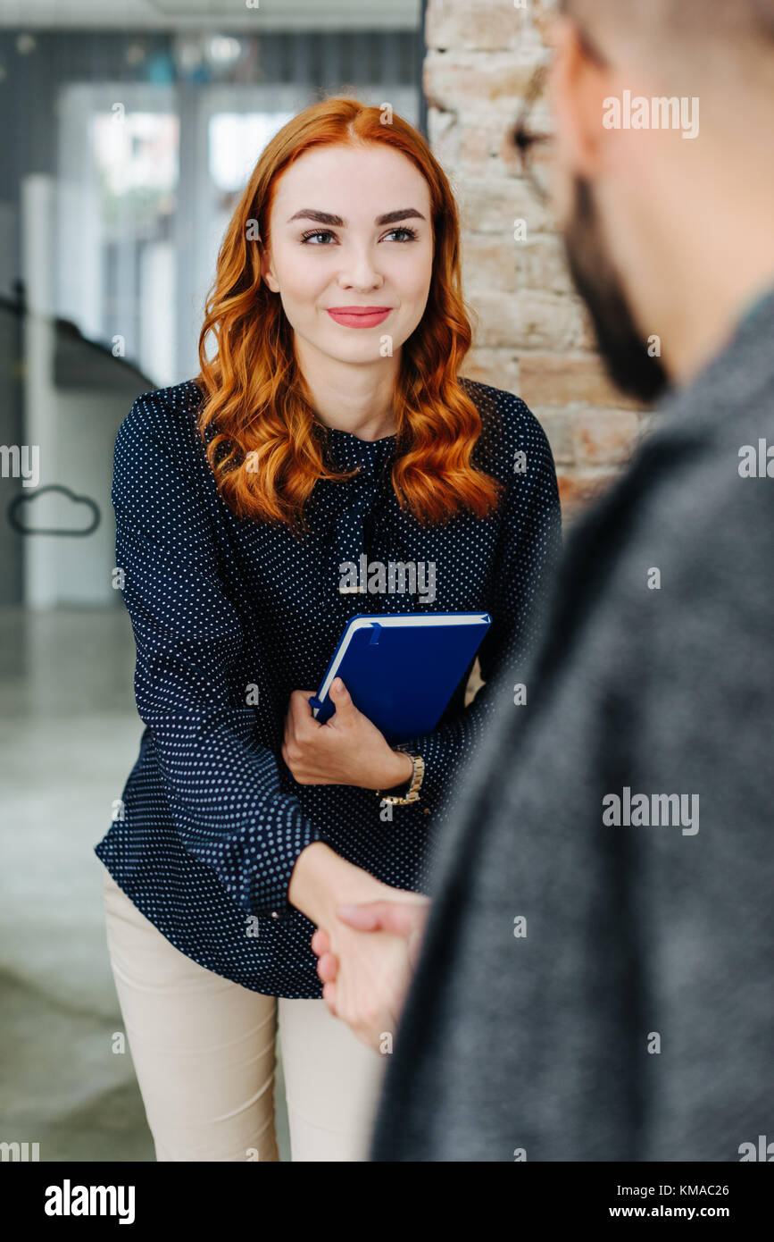 Young job hunter at a job interview - Stock Image