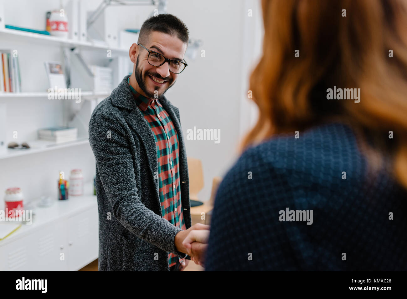 Sharp-minded executive welcoming his new employee - Stock Image
