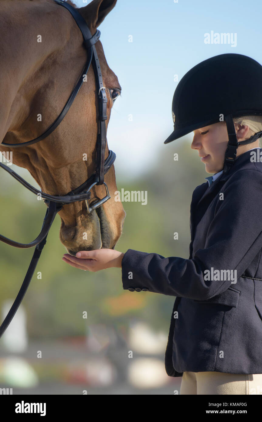 Intimate moment with Pony and Pre-teen girl at Hunter jumper show competition - Stock Image