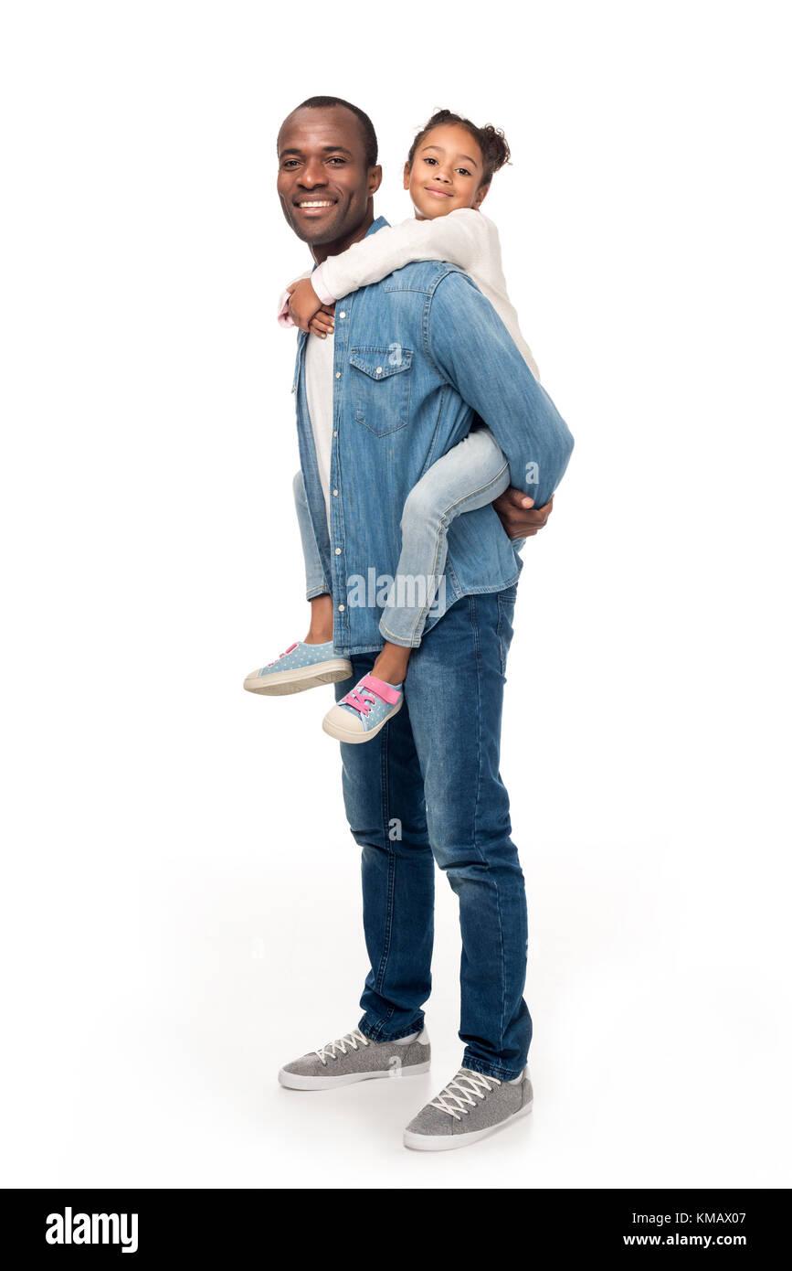 father piggybacking daughter - Stock Image
