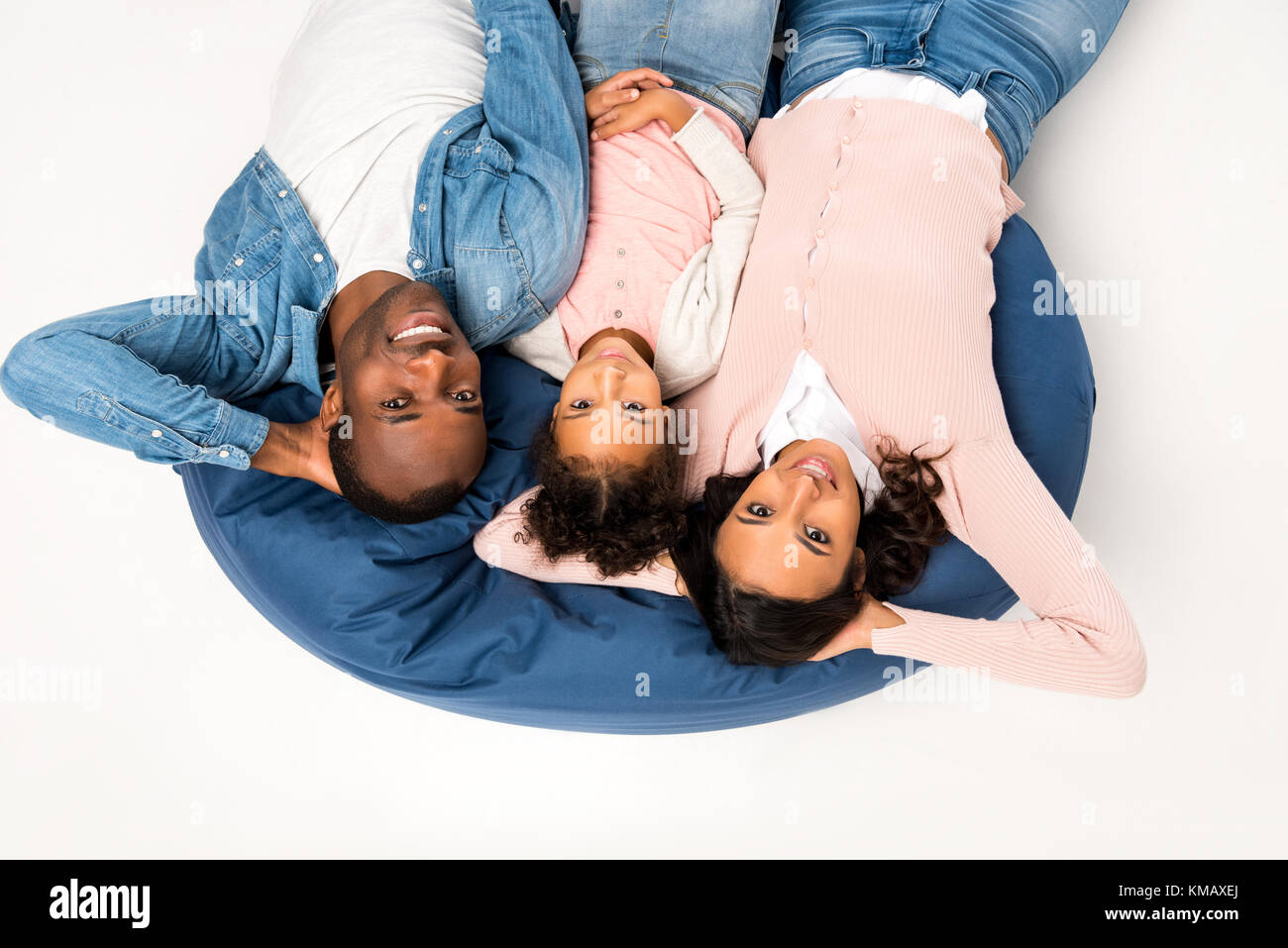 african american family on bean bag chair - Stock Image