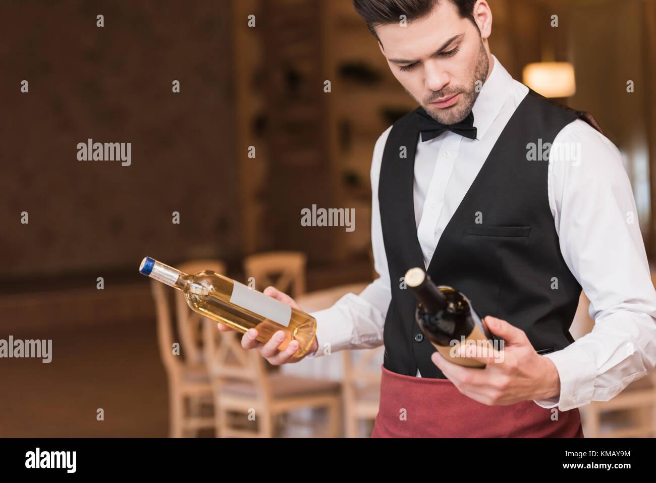 waiter choosing wine - Stock Image