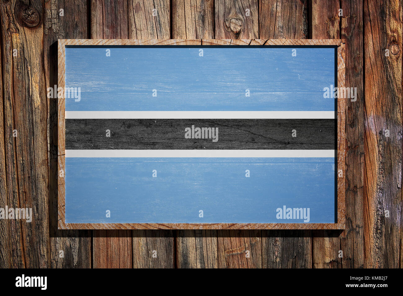 3d rendering of Botswana flag on a wooden frame over a planks wall ...