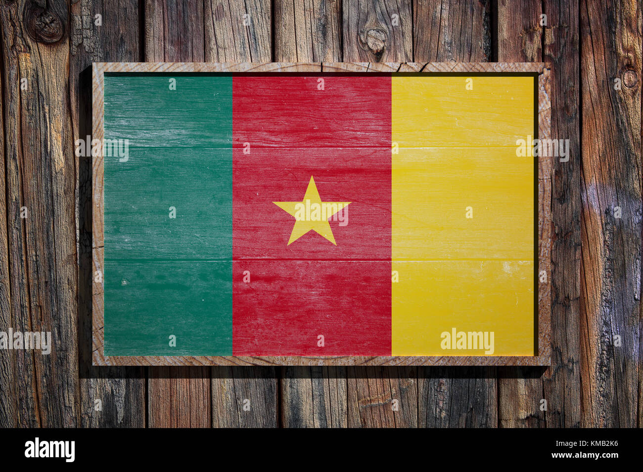 3d rendering of Cameroon flag on a wooden frame over a planks wall ...