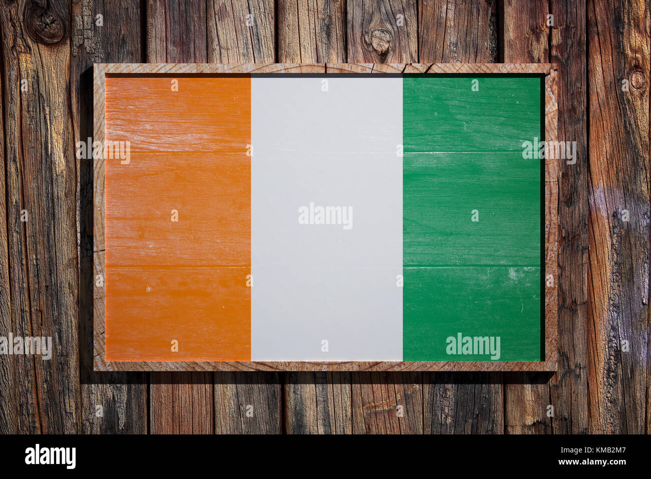 3d rendering of Ivory Coast flag on a wooden frame over a planks ...