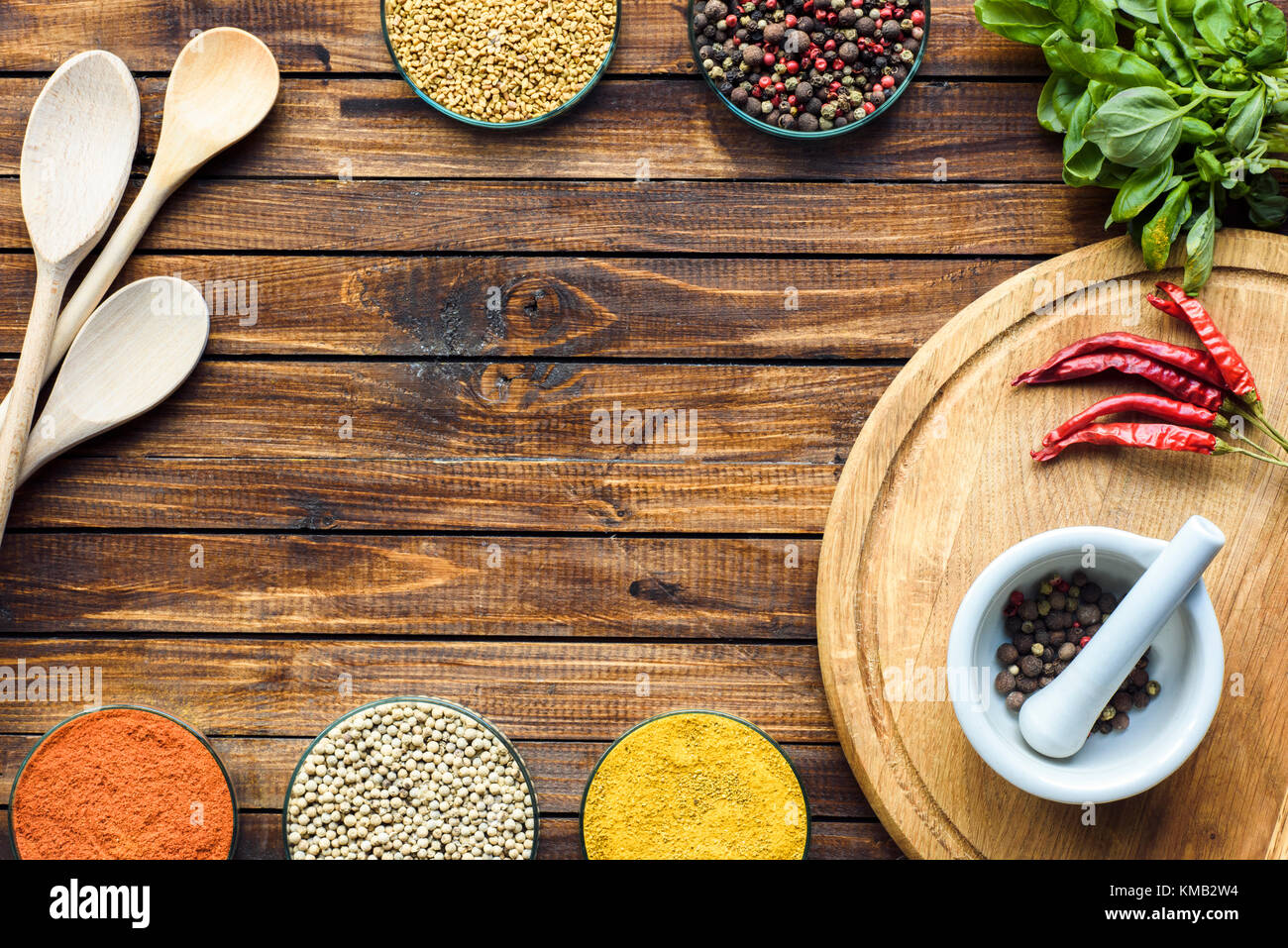 pestle and mortar on wooden board  - Stock Image