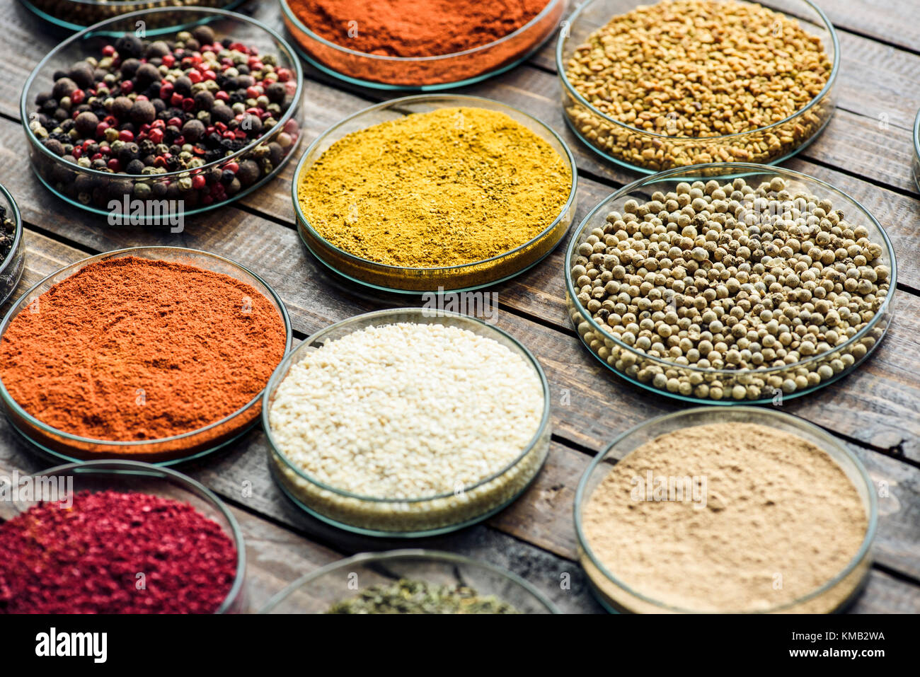 glass bowls with different colorful spices  - Stock Image