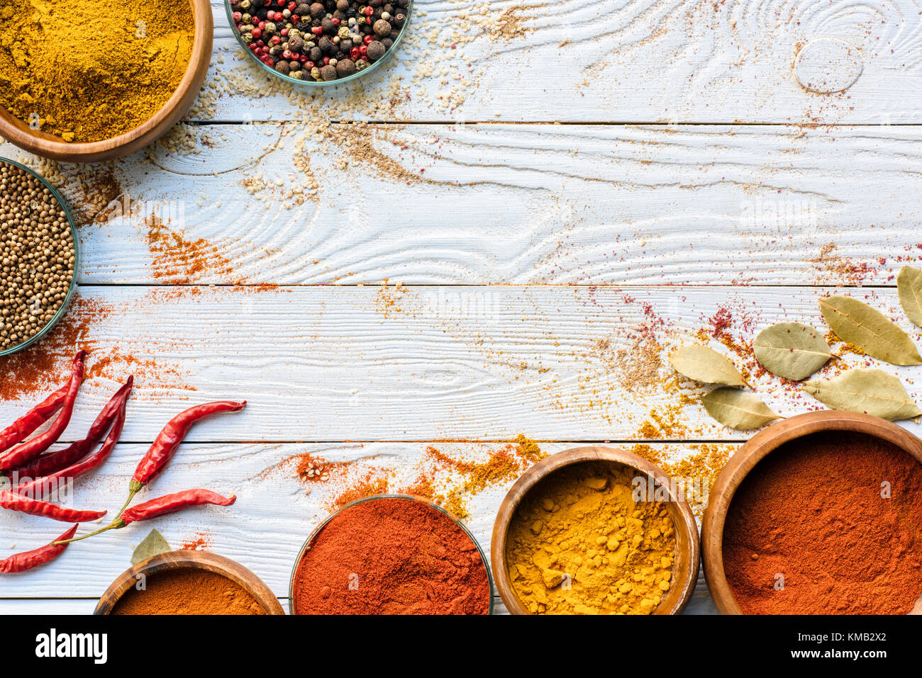 scattered spices and glasses with spices - Stock Image