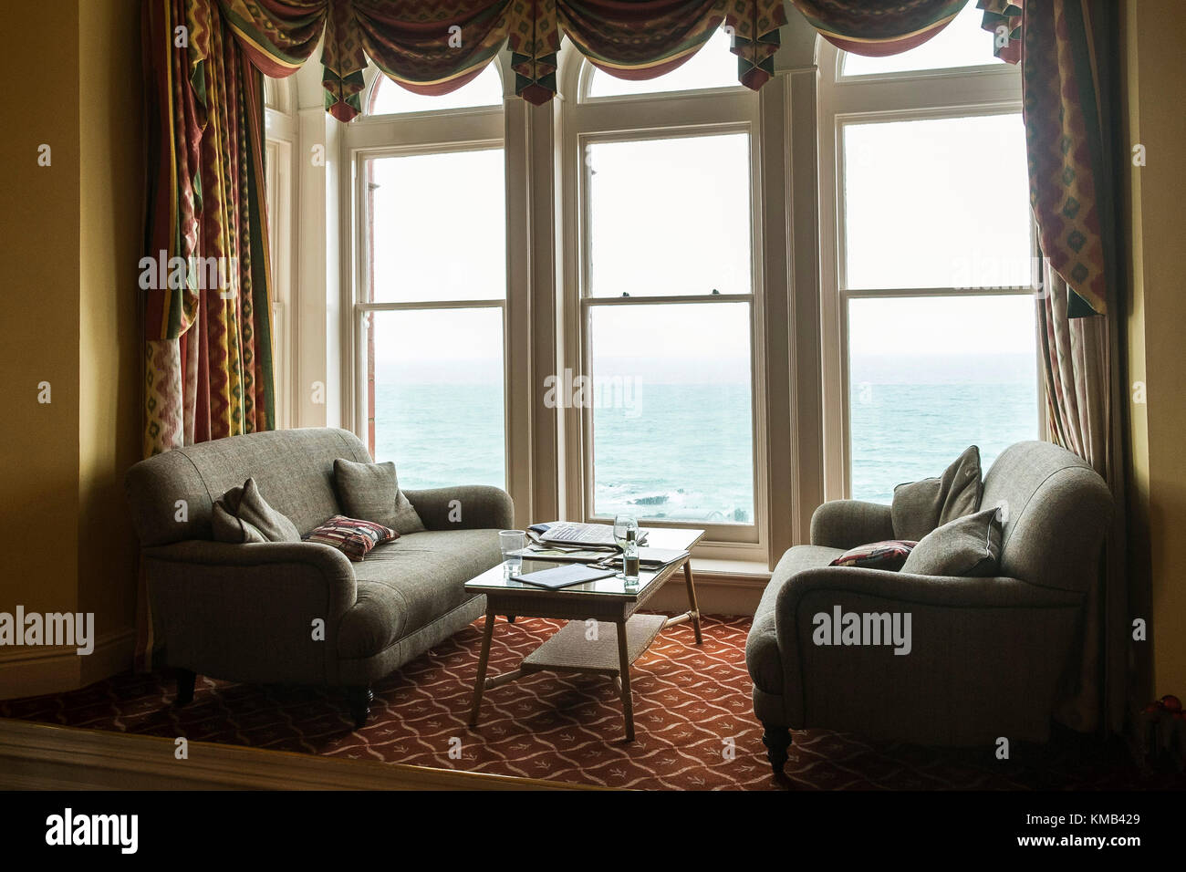 Two sofas settees in a window bay of a hotel. - Stock Image