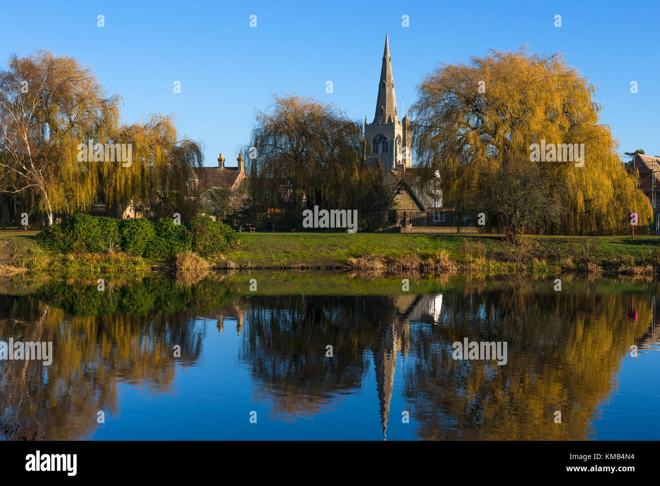 St. Mary the Virgin Church reflected in the lower pool off Great Ouse river, Godmanchester, Cambridgeshire, England, - Stock Image