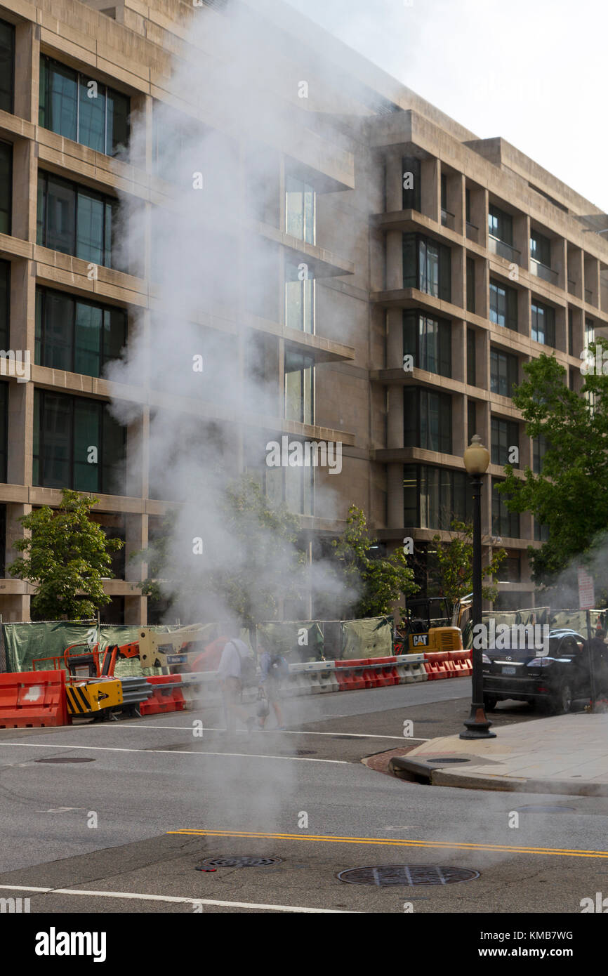 Steam rising from a road vent in Washington DC, United States. - Stock Image