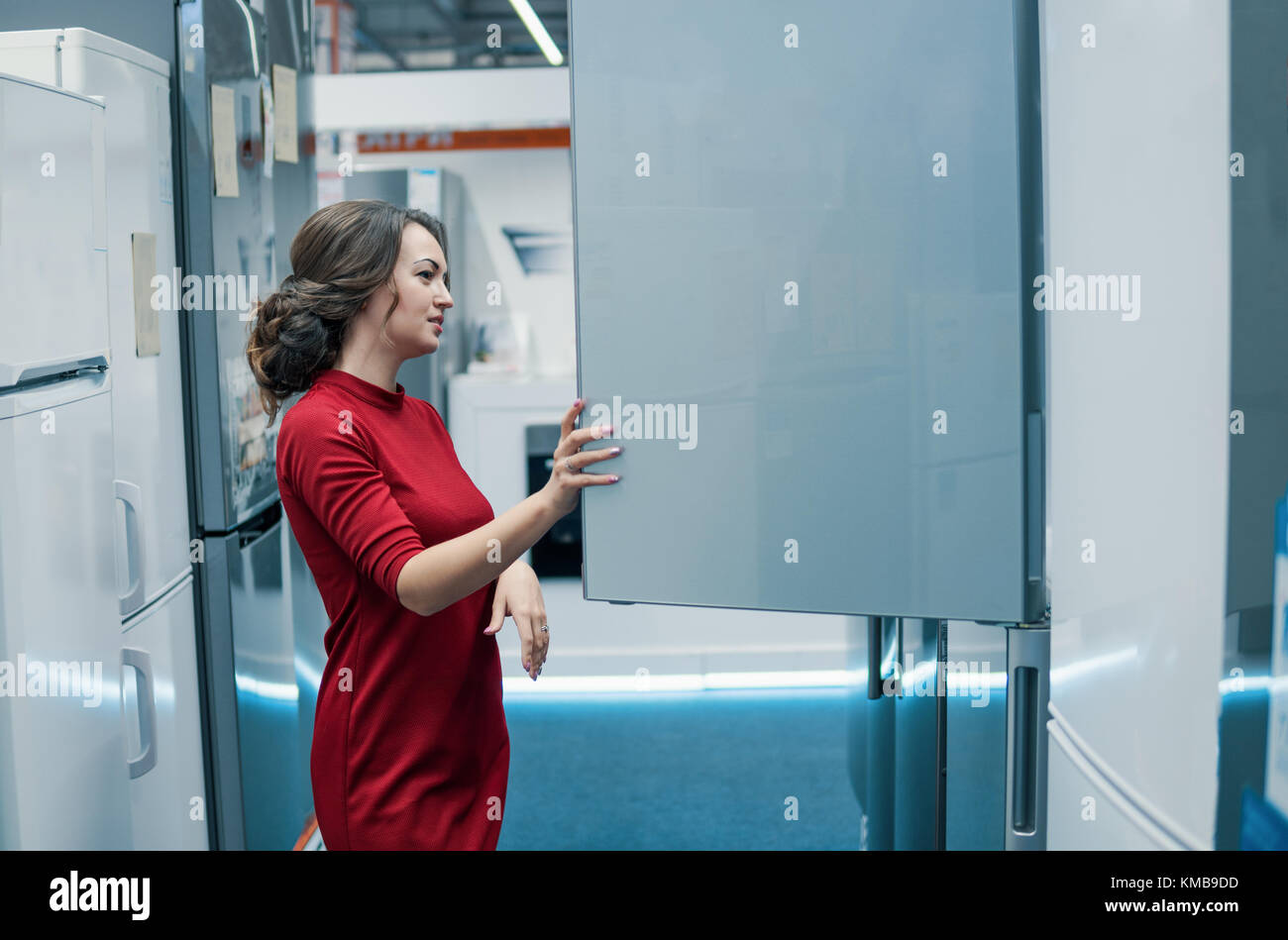 customer choosing large fridges in domestic appliances section - Stock Image