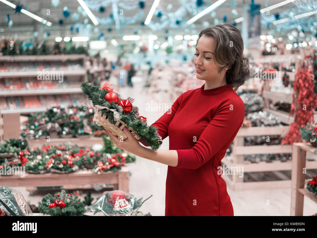 customer woman choosing Christmas decorations Stock Photo