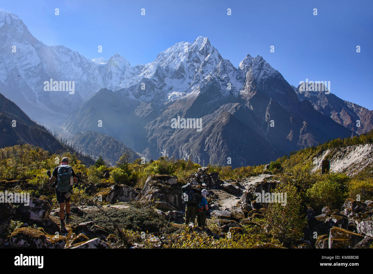 Trekkers with the view of Phungi Himal on the Manaslu Circuit Trail, Nepal - Stock Image
