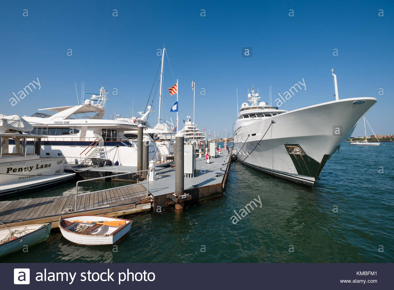 Large luxury yachts moored to floating pier in the Boston Waterboat Marina, North Atlantic Ocean, Boston, Suffolk - Stock Image
