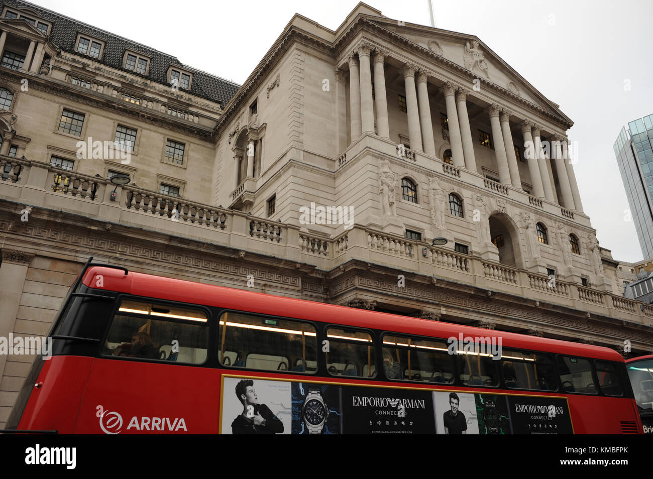 A bus goes past the Bank of England on Threadneedle Street in London - Stock Image