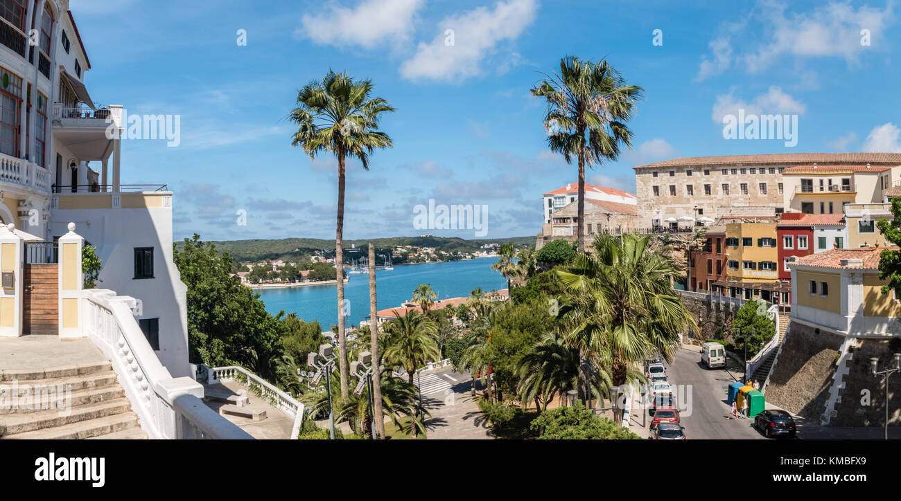 Palm trees and view of old town and port in Mahon, Menorca - Stock Image