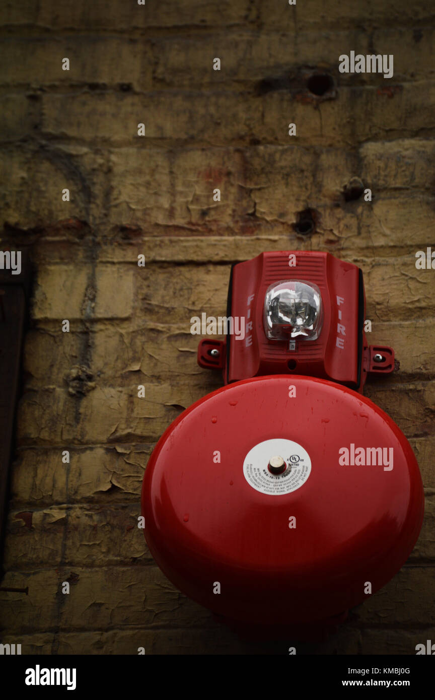Fire Alarm on Brick Wall - Stock Image
