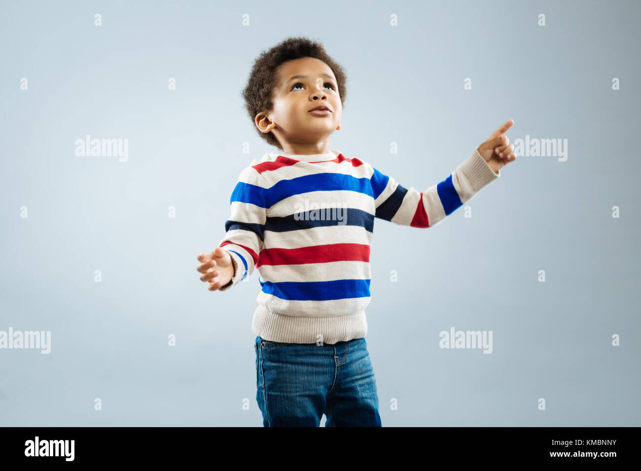 Enigmatical African child looking upwards - Stock Image