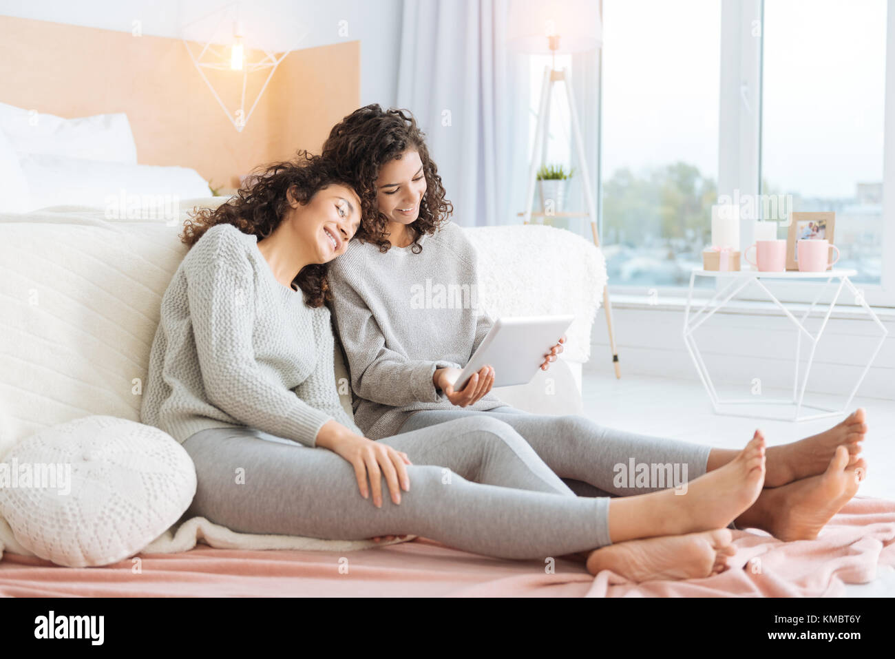 Loving siblings watching videos on touchpad together - Stock Image