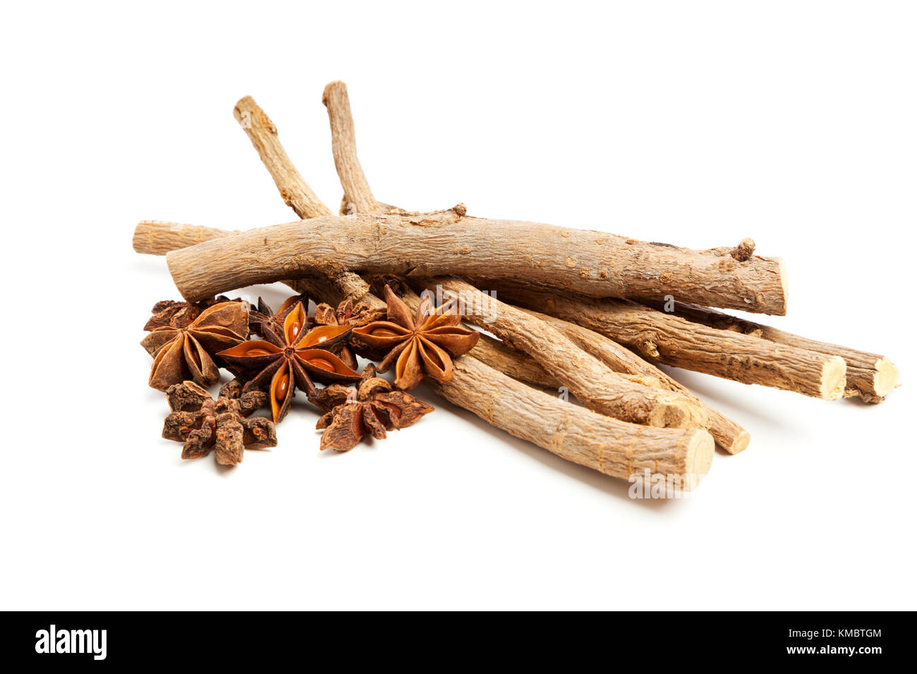 Licorice roots and star anise isolated on white background - Stock Image