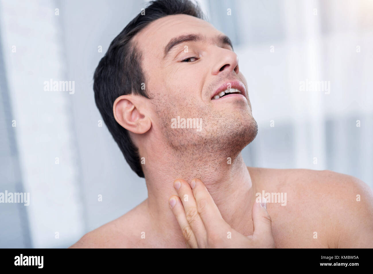 Relived satisfied man admiring his handsomeness Stock Photo