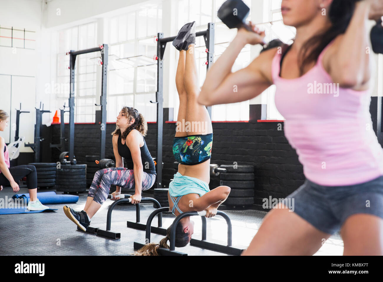 Young women working out in gym - Stock Image
