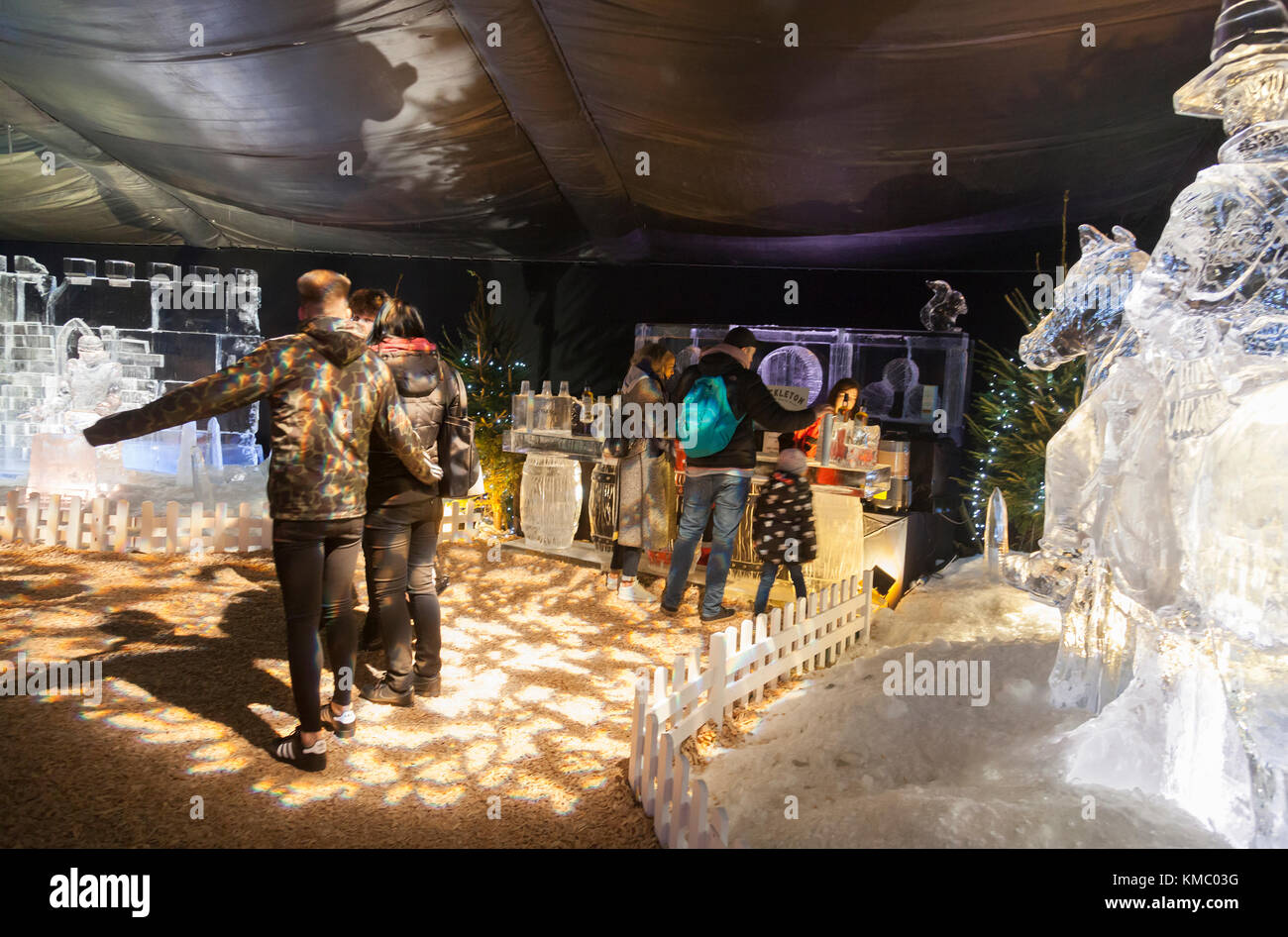 Visitors viewing Mary Queen of Scots blindfolded at her execution carved out of ice and visiting the Ice Bar, Glasgow's - Stock Image