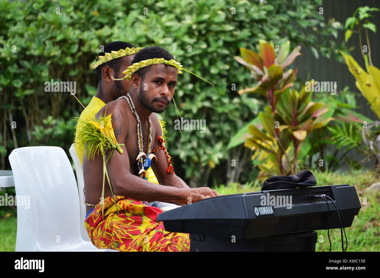 Islanders singing and playing musical instruments taken at Papua New Guinea - Stock Image
