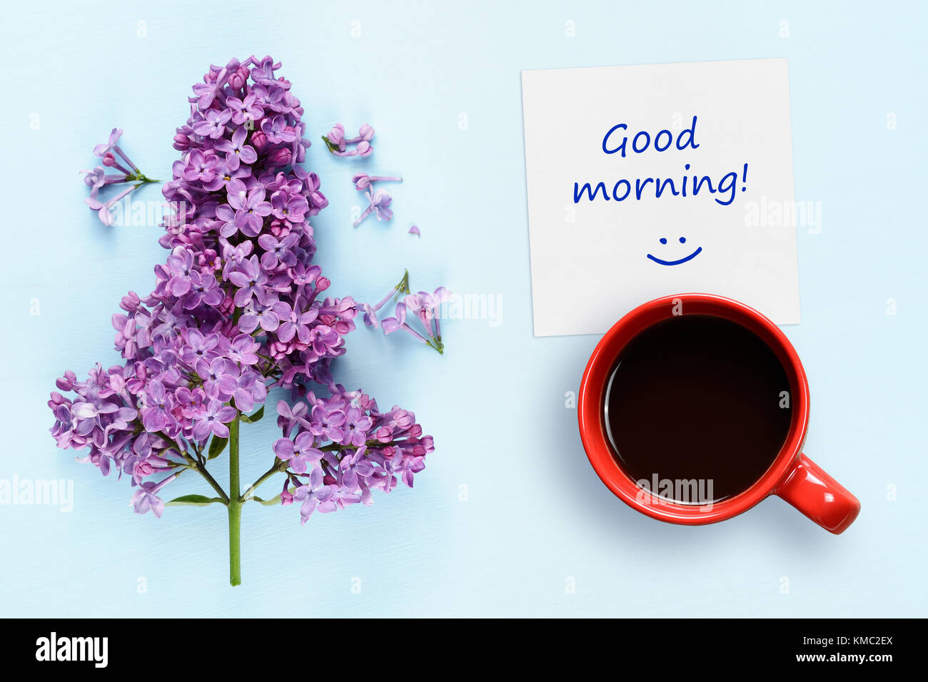 Good Morning Wishes Coffee Cup And Lilac Flowers On Blue Background