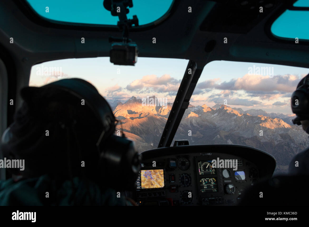 Interior of the cockpit of helicopter in flight on the Dolomites, South Tyrol, Italy - Stock Image