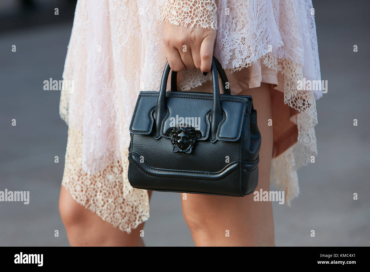 5b0e92b61251 MILAN - SEPTEMBER 23  Woman with black leather Versace bag and pink  embroidery dress before Gabriele Colangelo fashion show