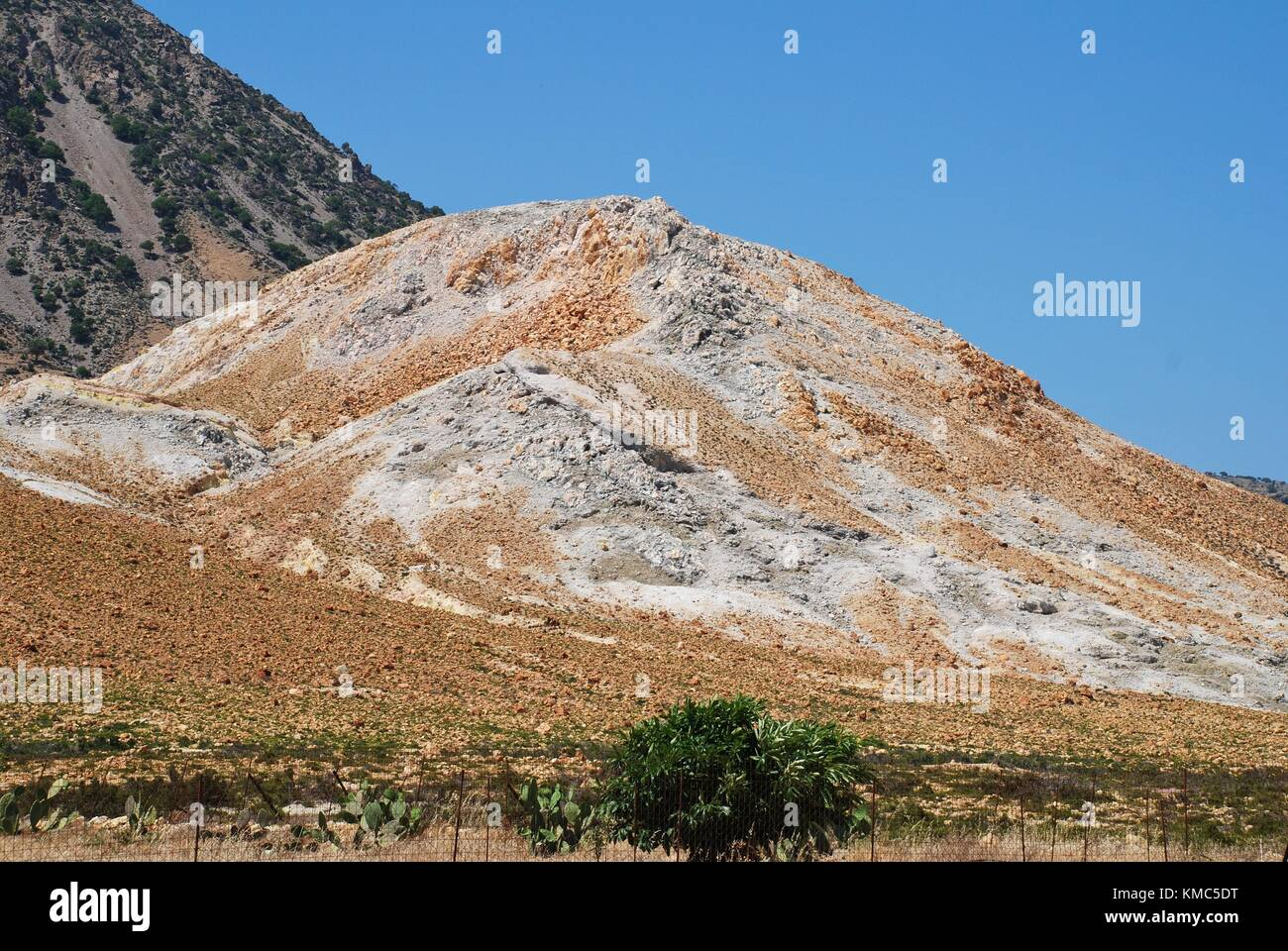 Volcanic rock formations by the Stefanos volcano crater on the Greek island of Nisyros. Stock Photo